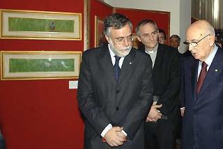 Il Presidente Giorgio Napolitano durante la visita alla Mostra allestita nell'Istituto Italiano per l'Africa e l'Oriente, accompagnato dal Fondatore della Comunità di Sant'Egidio Andrea Riccardi e da Don Matteo Zuppi